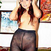 Non-professional gals flashing her goodies thru patterned pantyhose.