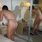 Non-professional beauties photos previous to the mirror in their pantyhose.