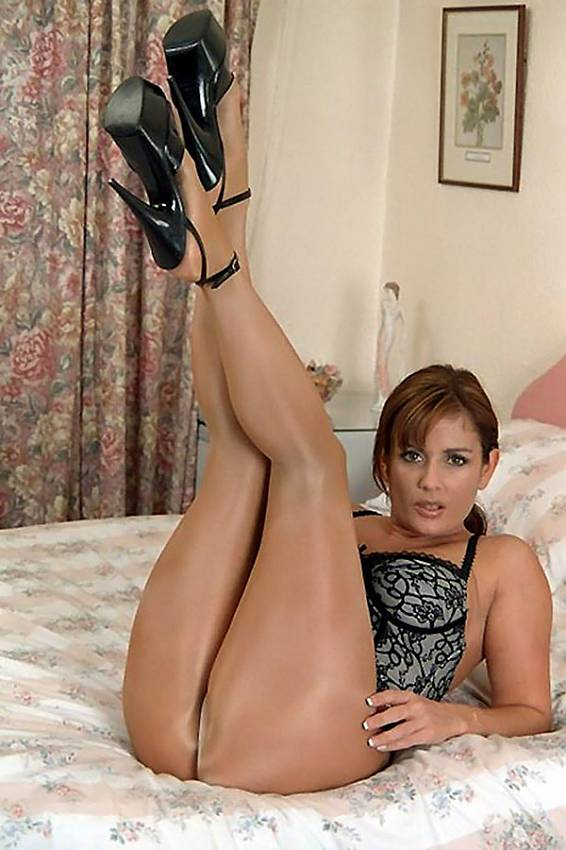 Milf Stockings <b>milf</b> in shiny seamless pantyhose and high heels on the bed <b></b>