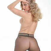 Photoshoot with golden-haired in dark seamless pantyhose.