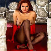 Redhead goddess in brown sealess pantyhose.
